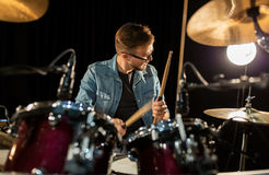 Male musician playing drums and cymbals at concert Royalty Free Stock Images