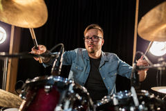 Male musician playing drums and cymbals at concert Stock Image