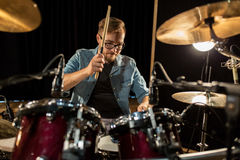 Male musician playing drums and cymbals at concert Royalty Free Stock Photos