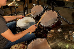 Male musician playing drums and cymbals at concert Stock Photography