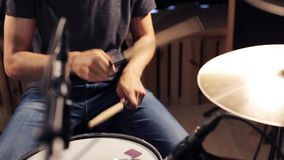 Male musician playing drums and cymbals at concert stock video footage