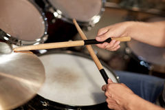 Male musician playing drums and cymbals at concert Royalty Free Stock Image