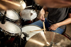 Male musician playing drums and cymbals at concert Stock Photo