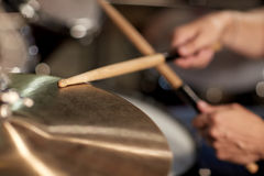 Male musician playing drums and cymbals at concert Royalty Free Stock Photo