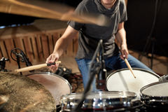Male musician playing drums and cymbals at concert Stock Images