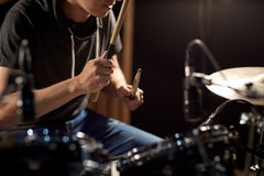 Male musician playing drums and cymbals at concert Royalty Free Stock Photography