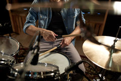 Male musician playing drums and cymbals at studio Royalty Free Stock Photos