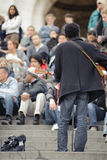 Male musician playing in the street near Sacre Coeur for money Stock Image