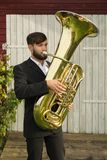 Male musician playing tuba Royalty Free Stock Image