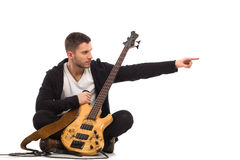 Male musician pointing. Royalty Free Stock Photos
