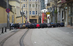 Male Muslims praying in the street. Istanbul, Turkey Stock Photography