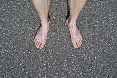 Male naked feet on cement Stock Photography