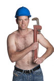 Male with naked torso, blue helmet  and wrench Royalty Free Stock Photo