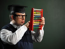Male nerd holding abacus Stock Photo