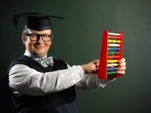 Male nerd holding abacus Stock Image