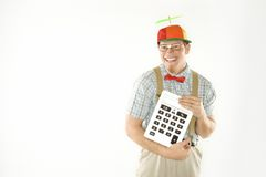 Male nerd holding calculator. Royalty Free Stock Photography