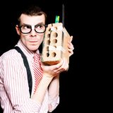 Male Nerd Inventor Holding Brick Mobile Telephone Stock Photos