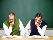 Male nerds reading books Stock Photography