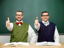 Male nerds show thumbs up stock photography
