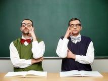 Male nerds thinking Royalty Free Stock Image
