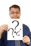 Male nerdy geek is holding text board royalty free stock photography