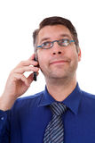 Male nerdy geek on the phone Stock Images