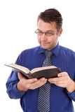 Male nerdy geek is reading a book Royalty Free Stock Photo