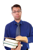 Male nerdy geek is reading books Royalty Free Stock Image
