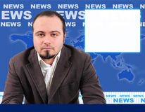 Male news presenter in studio. Male news presenter in blue studio, space for picture on the side Royalty Free Stock Photo