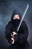 Male Ninja In Black Costume Holding Sword Stock Photos