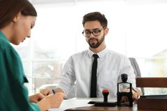 Male notary working with client