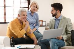 Male notary working with mature couple