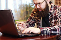 Male notebook work bearded Royalty Free Stock Images