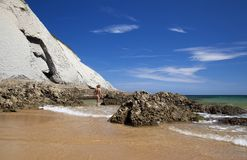 Male nudist on Playa de Covachos beach. Cantabria, Spain Stock Image