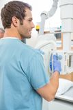 Male Nurse Adjusting Xray Machine Stock Photo