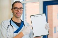 Male nurse with blotting pad Stock Photography