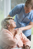 Male nurse caring about ill woman Royalty Free Stock Images