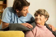 Male nurse caring about retiree Stock Image