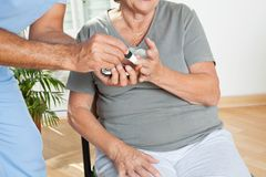 Male Nurse Checking Sugar Level Of Patient Stock Images
