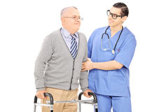 Male nurse helping a senior man with walker Royalty Free Stock Photography