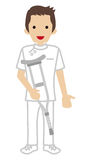 Male Nurse holding a Crutch Royalty Free Stock Photo