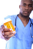 Male Nurse and Pills. African American Nurse and Pills Royalty Free Stock Photo
