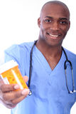 Male Nurse and Pills. African American Nurse and Pills stock image