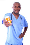 Male Nurse and Pills. African American male Nurse or Doctor waiting to serve a patient stock photo