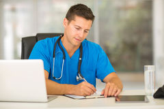Male nurse reports Royalty Free Stock Image