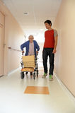 Male nurse and senior woman with walking frame royalty free stock photos