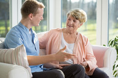 Male nurse and senior woman Stock Images