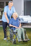 Male Nurse Standing With Senior Woman On Royalty Free Stock Image