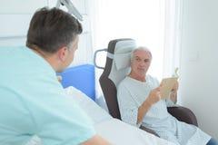 Male nurse taking care about senior patient. Nurse Royalty Free Stock Images