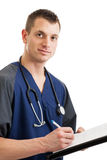 Male nurse taking notes Royalty Free Stock Images